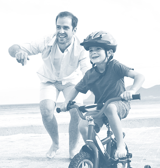 boy on bike with dad